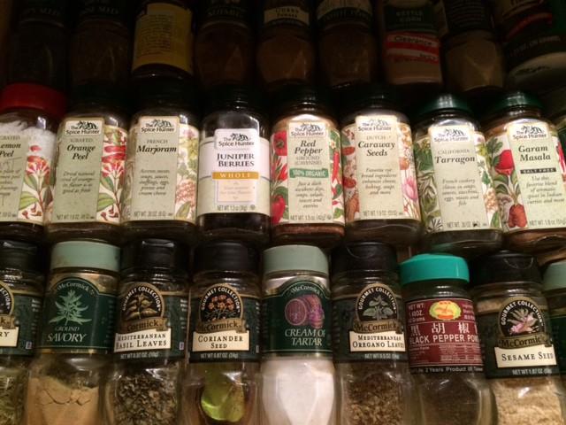 Kitchen drawer full of spice bottles
