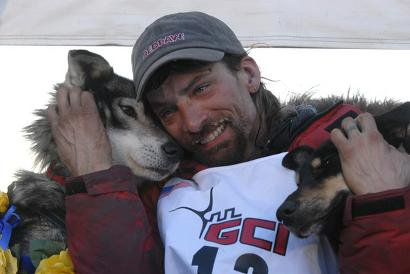 4-time Iditarod champion Lance Mackey with his dogs Rev and Maple